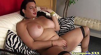 Curvy transsexual playing with her dick
